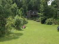 Rare Cottage on 20 Acres- 945 FEET of Water frontage