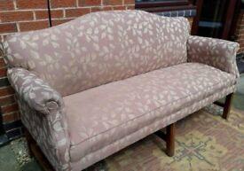 Arts and crafts sofa with decorative wooden legs.