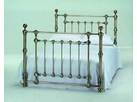 antique brass xolour bed, chandelier and curtain pole.