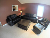 Black Leather Couches + Leather Ottoman