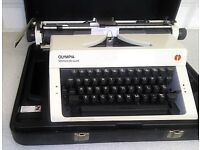 TYPEWRITER OLYMPIA MONICA DE LUXE VGC WITH MANUAL AND CASE