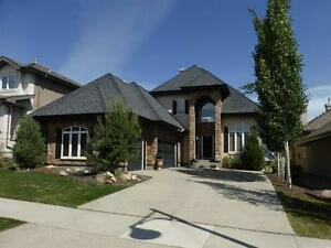 REDUCED! Executive Walkout Bungalow, 3 Fireplaces, Triple Garage