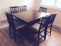 Quality wooden table set (pub style) with 8 chairs
