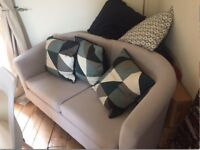 Duck blue Sofa and designer cushions