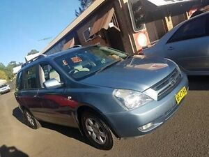 2006 Kia Grand Carnival VQ (EX) Blue 5 Speed Automatic Wagon Campbelltown Campbelltown Area Preview