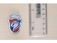 Ghia Badge - metal - very nice condition. 76p postage to UK mainland addresses.