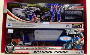 transformers deluxe optimus prime with mech tech trailer