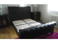 Kingsize black leather buttoned sleigh bed