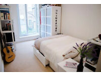 Larger than average room with en-suite shower and Juliet balcony within mins to 2 tube stations