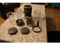 NutriBullet 600W NB-101S with 4 cups, 2 blades, two lids and a handle attachment