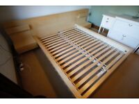 Ikea king size wooden bed frame and 2 side attachments.