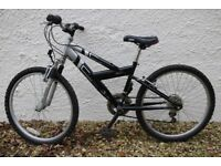 Mountain bike for sale. Used. Trojan Emmelle Revoshift with slime tyres. Good working order. Black.