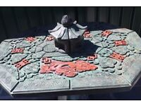 Japanese style garden table in green/red. Beautifully decorated. Very heavy.