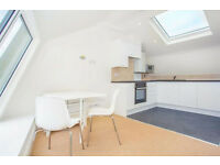 A stunning two bedroom penthouse with lots of light at the door step to Barons Court