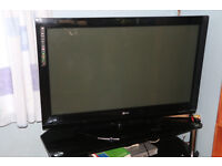 42 inch plasma TV and glass stand