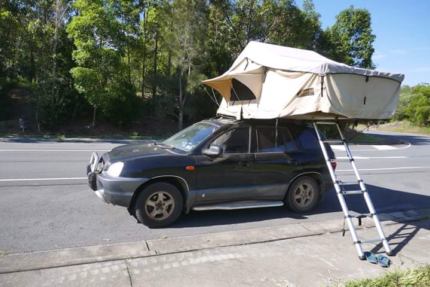 4WD Hyundai Santa Fe with rooftop tent and camping gear