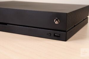 Xbox One X with Games and Controller