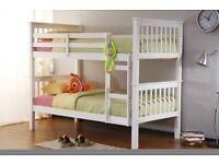 white wooden single bunkbeds