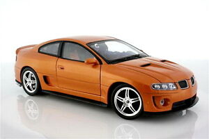 2005-Pontiac-GTO-Monaro-Orange-Welly-1-24-Scale-Model