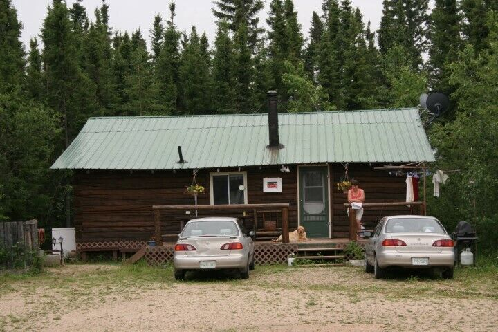 Nice log cabins for sale, small & secluded camp, close to city