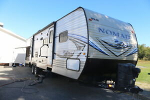 2015 NOMAD 312S  TRAVEL TRAILER WITH 2 BEDROOMS OUTSIDE KITCHEN