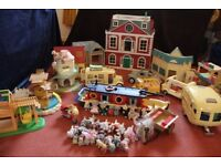 Large collection of Sylvanian Family toys.