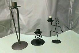 3 black metal candlestick holders