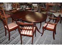 LARGE TWIN PEDESTAL EXTENDING DINING TABLE AND SIX CHAIRS