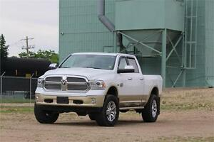 2014 Ram 1500 Longhorn with 4 inch lift with rims and tires
