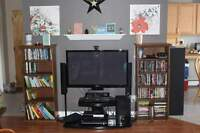 Swiveling TV stand with two glass shelves