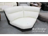 contemporary corner seat in two tone black and white leather