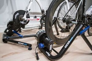 Road bicycle and bicycle trainer pair.
