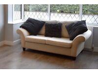 Cream 2 seater sofas