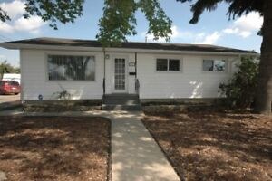 Completely Renovated Bungalow w/LEGAL BSMT Suite close to LRT