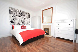 Modern, light, very large and airy 2-bed, 2-reception garden flat in Raynes Park