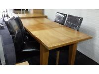 Ex-display solid oak extending dining table & 4 chairs