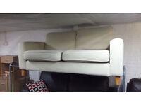 Ex-display Cream fabric large 2 seater sofa