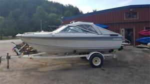 16.5' CADORETTE BOW RIDER IN GOOD CONDITION WITH TOP AND TRAILER