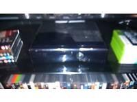 Black Xbox 360 slim with games
