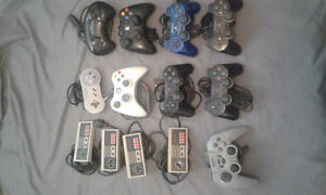 Big lot of various game controllers.