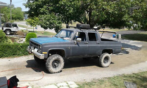 lifted 4 door 4x4 squarebody Chevy for sale or trade