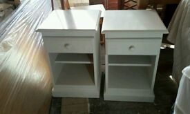 White wooden bedside tables