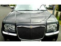 Chrysler 300C Estate black with tinted windows