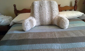 Bed cushion with arms