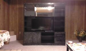 Black  with grey design entertainment unit, and 2 tables