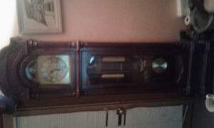 GRANDFATHER CLOCK IN EXCELLENT CONDITION...