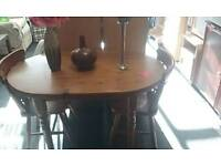 Oval pine table and two chairs