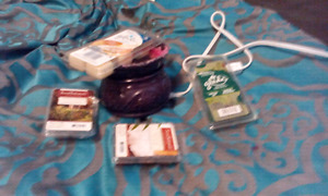 Candle warmer and a variety of open wax packages 15