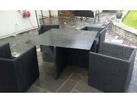 "black rattan garden furniture ""the cube"" patio set.Table & 4 chairs. Painted glass table top."