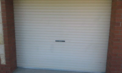 Roller doors with motors and remotes 4sale